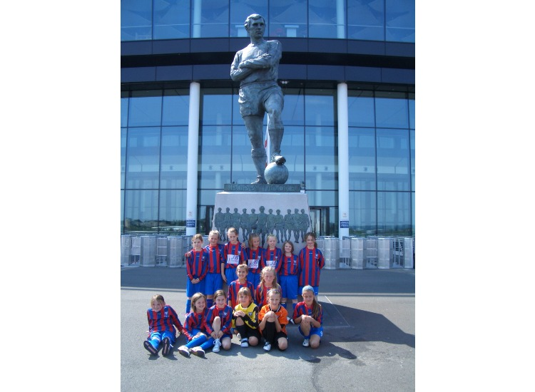 At the Sir Bobby Moore statue