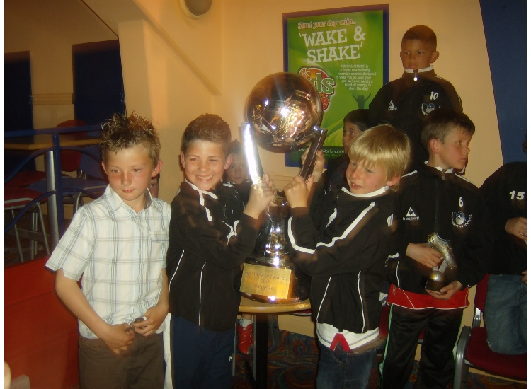 Daniel Hawkins, Diego Mora-Madden and Harry Waite with the  SCi Trophy Winners Trophy 2009/10