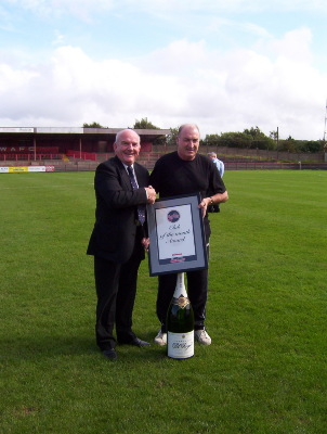 Tommy Cassidy receives a team of the month award from Witton Albion Chairman, Mike Worthington